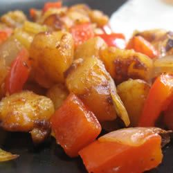 Home-Fried Potatoes......This is how I do my fried potatoes except I don't boil them first...just peel...or not.....dice and fry. We like garlic, so I add fresh or powdered to the mix......Quite Yummy!...... Allrecipes.com