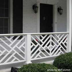 """""""Chippendale railing.""""  I love this. It looks great with the white painted brick and the black shutters, door and lanterns."""