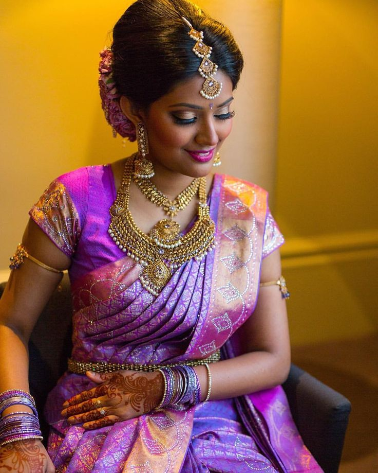South Indian bride. Gold Indian bridal jewelry.Temple jewelry. Jhumkis. Lavender purple silk kanchipuram sari.Braid with fresh flowers. Tamil bride. Telugu bride. Kannada bride. Hindu bride. Malayalee bride.Kerala bride.South Indian wedding.