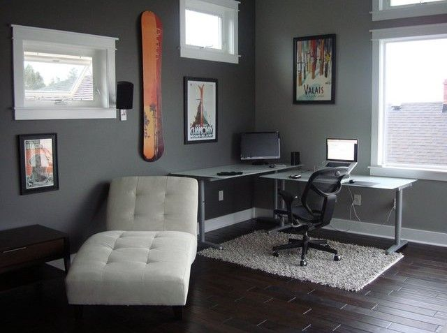 Lobby dark floors gray walls black and white furniture for Dark walls white furniture