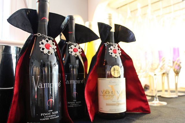 Added touch for a Halloween Party - Vampire capes on the wine bottles