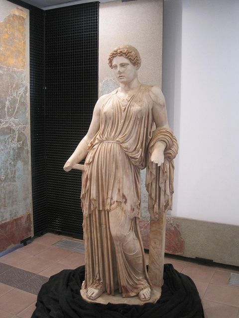 Beautiful painted statue from Herculaneum.  The paint is faded, and therefore easier on modern eyes, since we are used to seeing classical statues without painted surfaces.