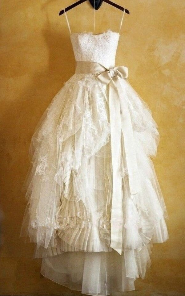 Oooh stunning vintage wedding dress. Love the big sash and the contrast of the textures against the big layered skirt.