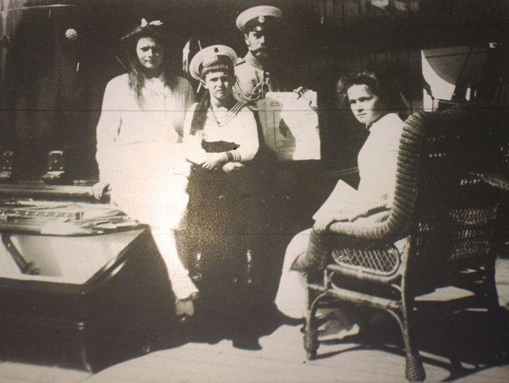 "Tsar Nicholas ll of Russia with three of his children,the Grand Duchesses Tatiana and Olga Nikolaevna Romanova of Russia and the Tsarevich Alexei Nikolaevich Romanov of Russia in 1911.  ""AL"""