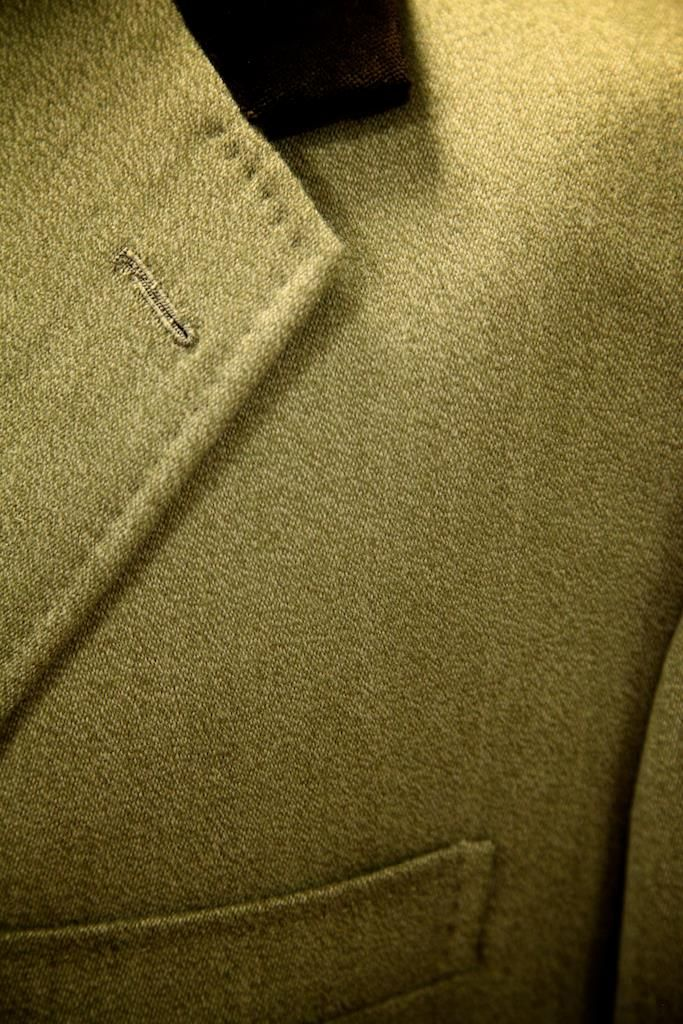 This traditional Covert Coat features contrasting velvet collar with additional velvet on the inside of the pocket flaps.