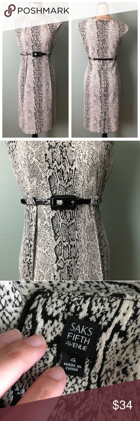 """Saks Fifth Avenue size 4 belted snake print dress! Saks Fifth Avenue size 4 belted snake print dress! Excellent condition. Belt included; belt has small signs of wear around the hole it was used on. Pleated neckline. Thicker fabric. Unlined. Cap sleeves. Approximate flat measurements: bust 17"""", waist 14.5"""", hips 18.75"""", length 36.5"""". I don't trade. Reasonable offers welcome. Thanks! 😊 Saks Fifth Avenue Dresses"""