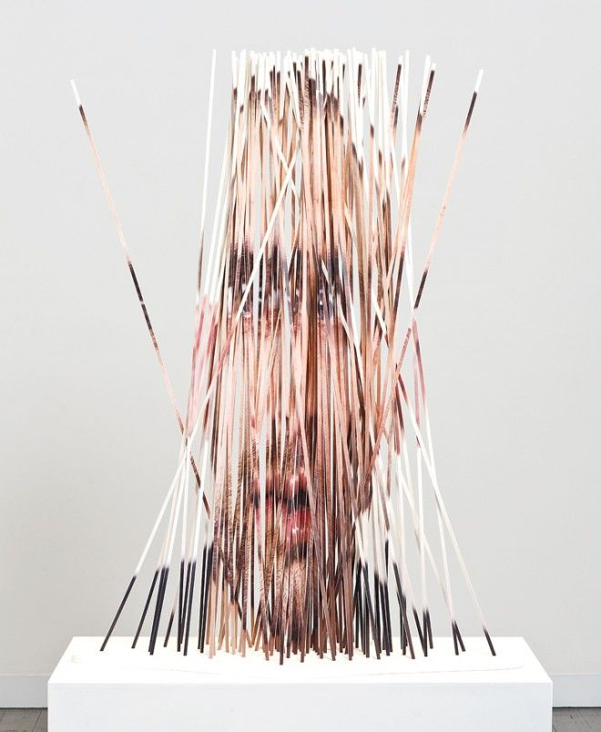 Artist Justine Khamara transforms her portrait photography into intricate and wonderfully distorted cut sculptures. Khamara starts with a photo of a face or body part, and then takes a knife, or la...