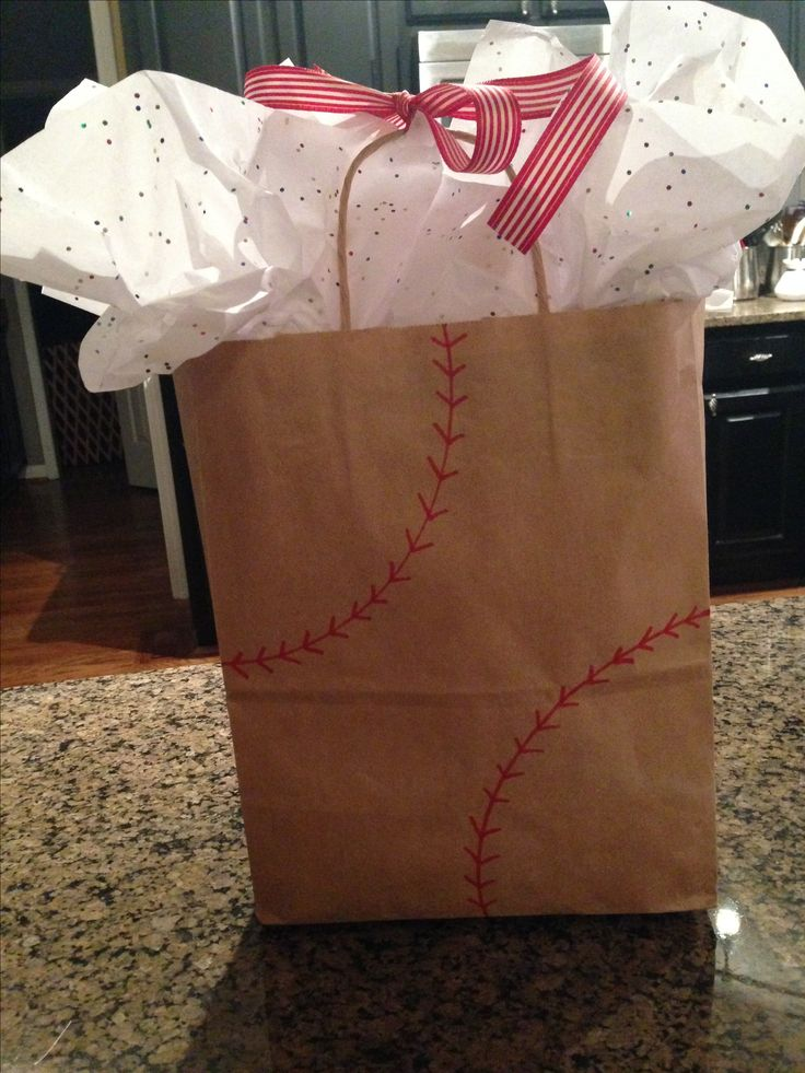 Plain gift bag can easily match the theme by drawing baseball threads. (like, seriously, it took less than a minute!)