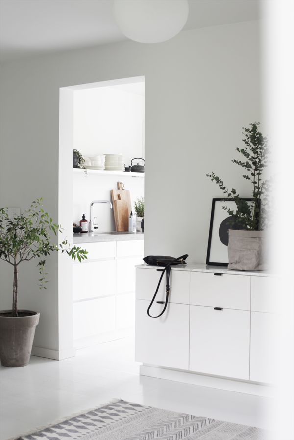 Hallway / entrance in the beautiful monochrome Norwegian home of Elisabeth Heier in summer time.