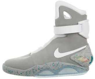 Nike Air MAG Self-Lacing Sneakers w/ Tags Limited Edition 36/89. From the Michael J. Fox Foundation 2016 Collaboration. Men's grey, white and teal Nike Mag Self Lacing Sneakers with round toes, white leather trim throughout, signature Swoosh details at sides, multicolor light-up technology at ankle strap, sides and outsoles, textured rubber soles featuring splatter paint embellishments, 'Nike Mag' logo at counters, foot molding capabilities, strap featuring designer logo and mechanical…