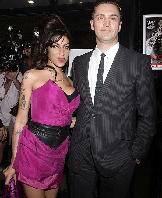 Happy ... Amy Winehouse was dating Reg Traviss when she died  ~1eyeJACK~