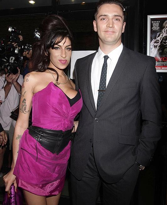 Happy ... Amy Winehouse was dating Reg Traviss when she died  ~1eyeJACK~