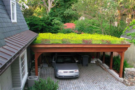 This carport's roof is visually and ecological appealing
