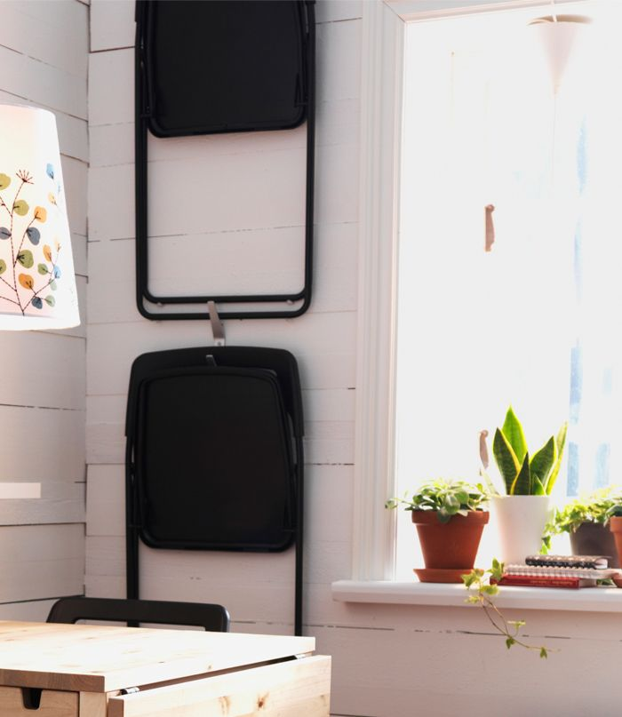 Fold The NISSE Chairs Up And Hang Them On The Wall To Save Space, £