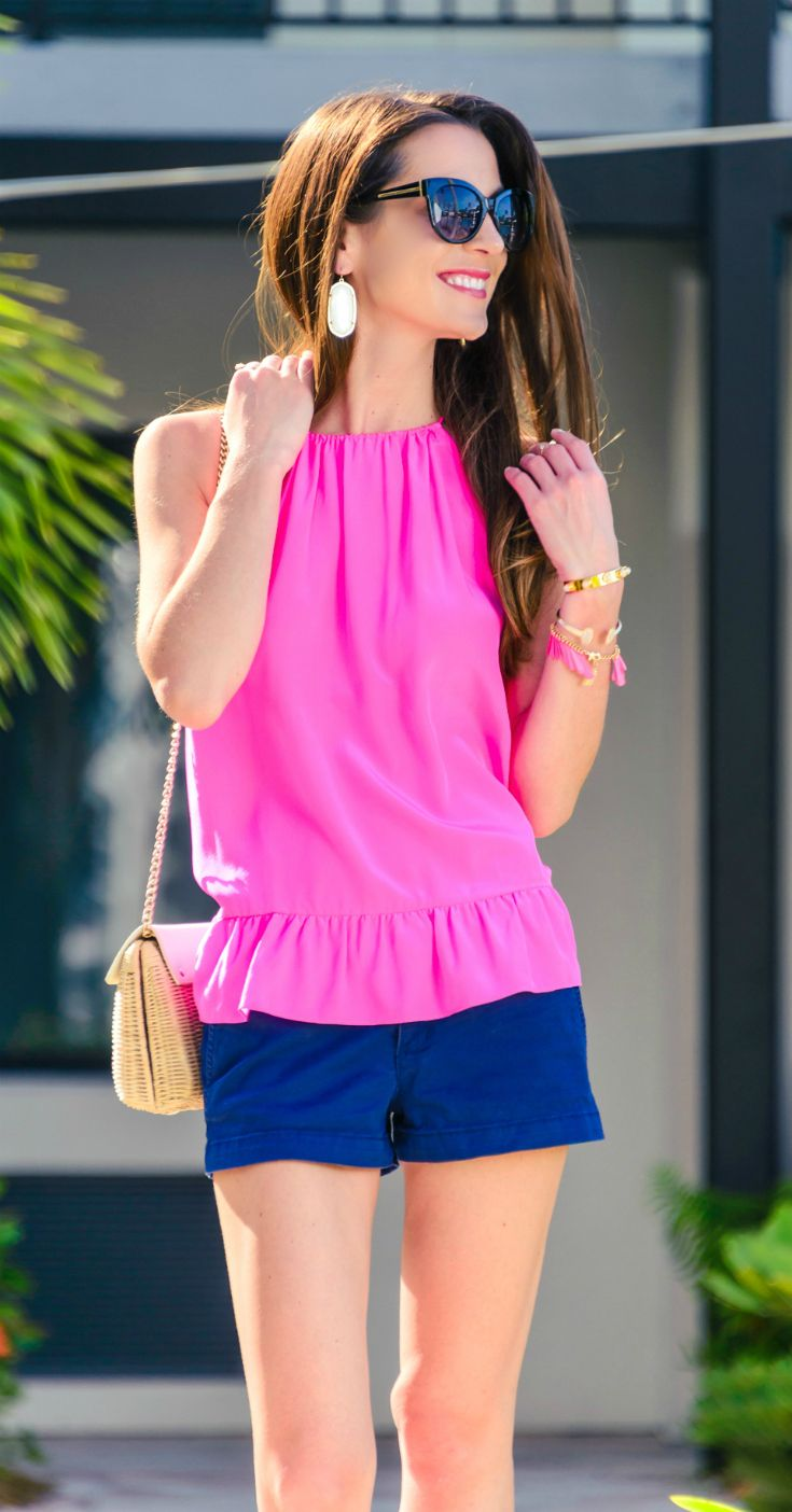 Hot pink Millie halter top from Lilly Pulitzer paired with navy blue shorts and white wedges. Cute summer look for vacation!