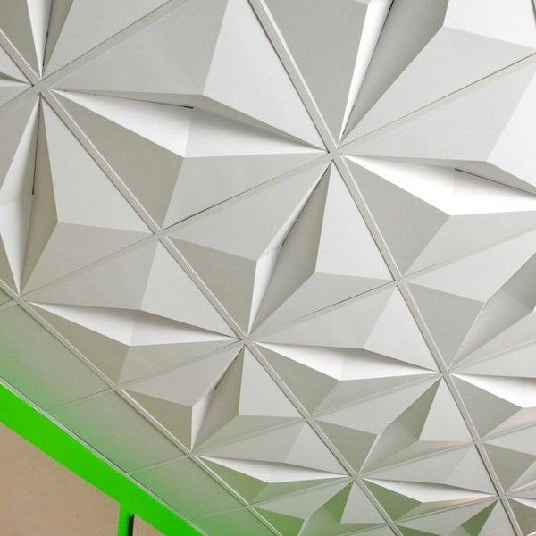 3D Drop Ceiling Tiles, Made from recycled cardboard and designed to ship flat and be folded at the installation site, the lightweight two by two foot modules are a cost effective and dramatic solution for spaces that require suspended ceilings.  http://hative.com/cool-basement-ceiling-ideas/
