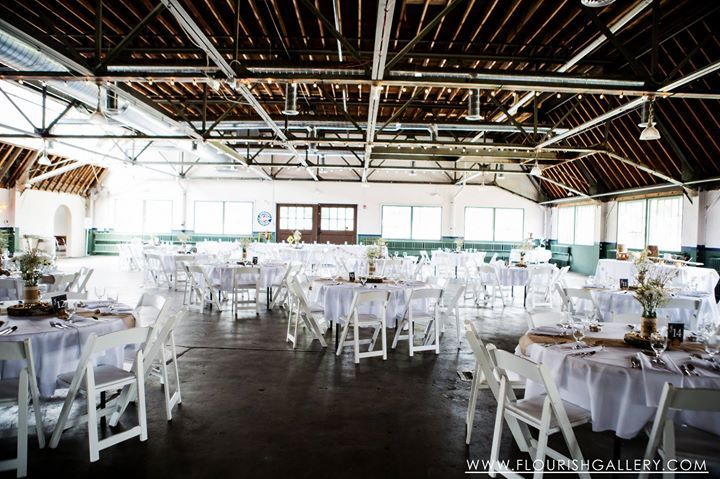 The Repair Garage at the Packard Proving Grounds all decked out and ready for a lovely rustic vintage wedding reception!  Thanks to Flourish Photography for sharing this lovely image