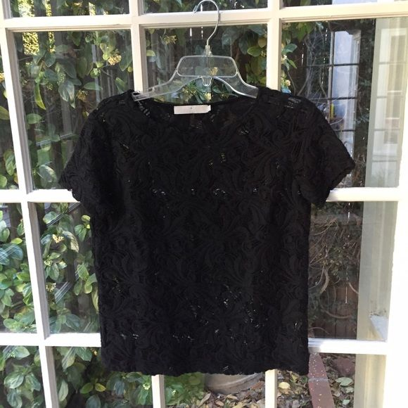 Black lace top Black thick lace top made from 90% cotton and 20% nylon. Dry clean only. Made in the USA. Kain Label Tops