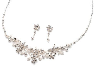 spectacular pearl jewelry set is finely hand crafted with genuine austrian crystals accented with delicate soft white faux pearls a beautiful pearl bridal