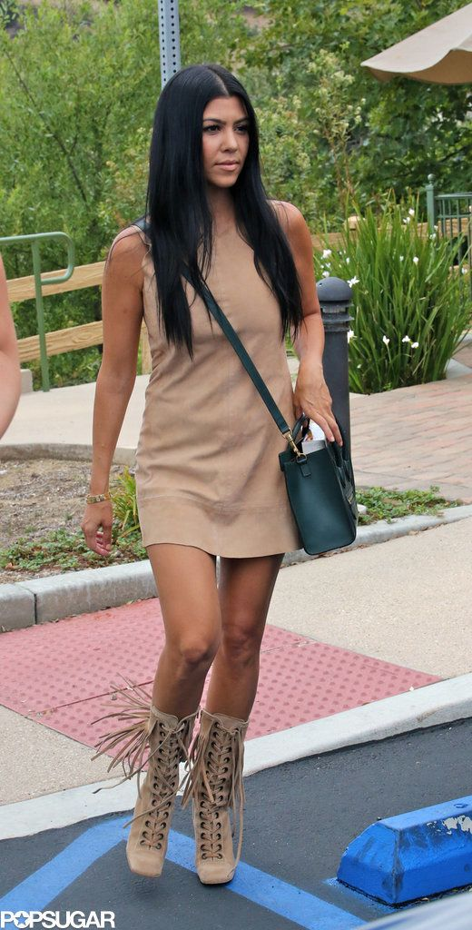 Kourtney Kardashian bonded with her family over lunch in LA on Tuesday. In the process, she basically advertised her hotness in a suede dress that revealed her insanely toned and tanned legs. The reality star arrived at the restaurant with sister Khloé Kardashian and son Mason Disick and met up with her mom, Kris Jenner, inside. Kourtney's latest outing comes less than a week after she turned heads with her hot looks at the Montage hotel in Beverly Hills on Friday, July 17.
