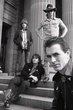 Tony Mott photographed Sydney band The Screaming Tribesmen on the steps of the Mitchell Library.