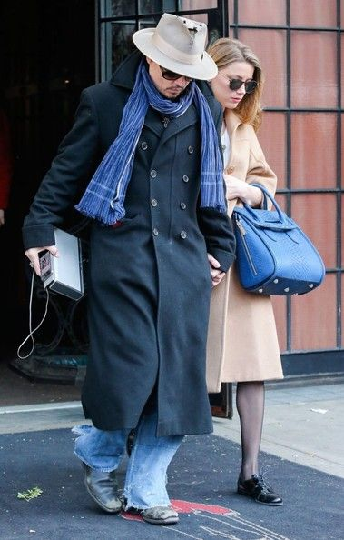 Amber Heard Photos - Engaged couple Johnny Depp and Amber Heard seen holding hands as they leave their hotel in New York City, New York on March 22, 2014. Johnny could really use a new hat as it has a bunch of holes in the front of the hat. - Johnny Depp & Amber Heard Leaving Their New York Hotel