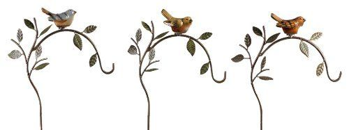 "Gift Craft 30.7-Inch Iron and Ceramic Bird Design Double Pronged Shepherds Hook Garden Stakes, Large by Gift Craft. $73.96. Double prongs ensure the stakes stay firmly in the ground. Durable iron construction. Outdoor safe. Add a touch of beauty to any outdoor setting with the set of three bird inspired garden stakes. each stake is crafted in iron and features leaf and branch design details. perched atop each stake is a ceramic bird. measures approximately 11"" x 3.9"" x 30.7""."
