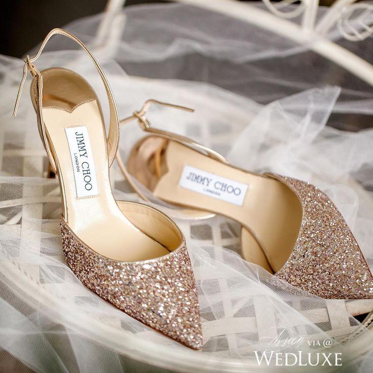 We're head over heels (literally) for these glittery #JimmyChoos! Photography By: Infused Studios | WedLuxe Magazine | #WedLuxe #Wedding #luxury #weddinginspiration #luxurywedding #weddingshoes