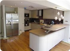 8m x 8m New family/social area, kitchen/louge/dining/rooflights & woodburner with bi-fold doors leading through level threshold doors to paved area