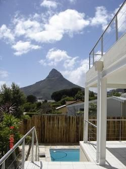 Entabeni Guest House - Situated in a cul-de-sac, high up on the slopes of Table Mountain, Entabeni Guest House commands panoramic and spectacular view, and is very centrally located to many large tourist attractions. Entabeni ... #weekendgetaways #campsbay #capetowncentral #southafrica