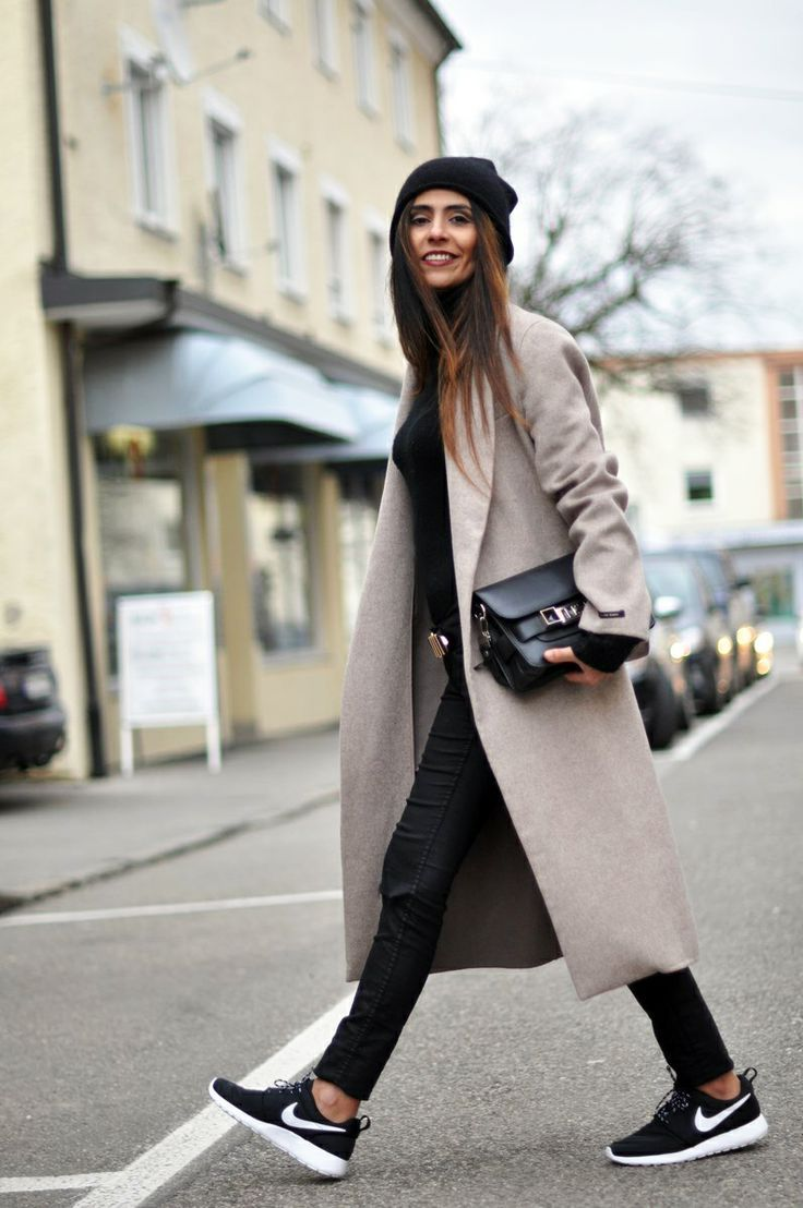 long coat, beanie, trainers