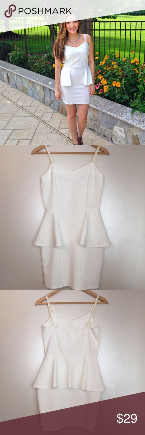 White Peplum Dress White peplum dress with adjustable straps. Size Small. Worn once, in excellent condition. Everly Dresses