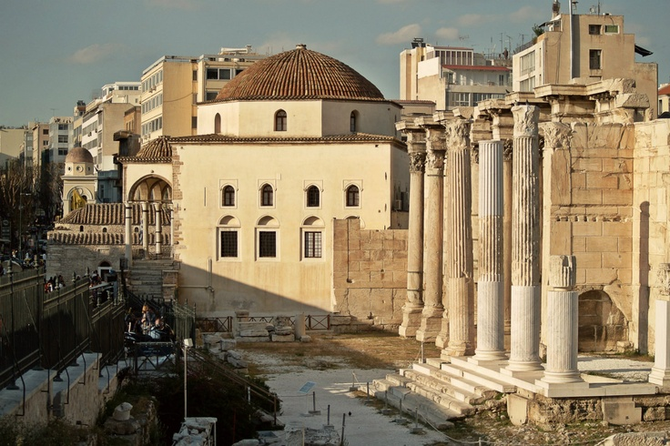 Two different eras of Athens coexist side by side. Roman period Library of Hadrian and Ottoman period Tzistaraki Mosque enrich the Athenian landscape. (Walking Athens - Route 04 / Plaka)
