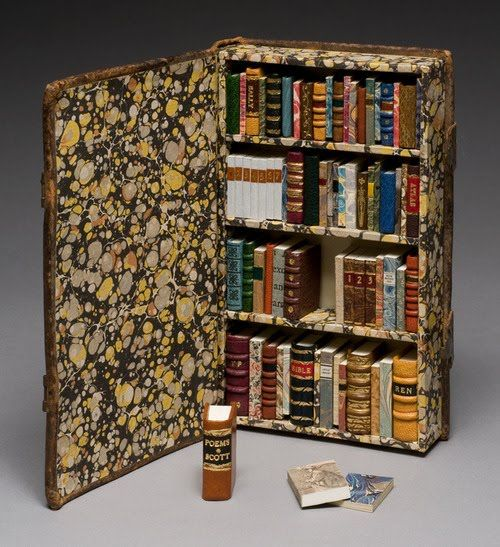"""LITTLE LIBRARY (2009) created by Todd Pattison (Book Binder & Conservator, Andover, Massachusetts). Altered early 19th-century leather binding with fore-edge clasps. The bookshelves hold seventy-two blank leather- and paper-covered books which open and range in height from 1"""" to 1.5""""."""