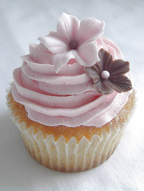 Pretty pink cupcake close up by cakejournal