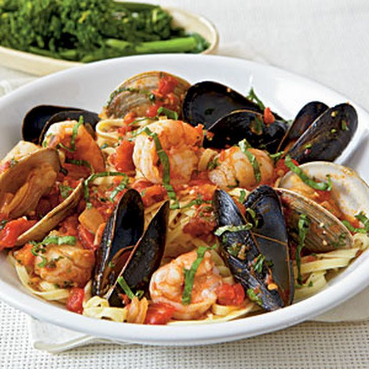 Seafood Arrabbiata Recipe Main Dishes with linguine, extra-virgin olive oil, bay scallops, medium shrimp, chopped onion, crushed red pepper, garlic cloves, tomato paste, diced tomatoes, clam juice, littleneck clams, mussels, fresh parsley, fresh basil