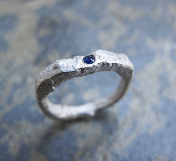 This rustic sterling silver ring with a flush set sapphire is handmade in my London Studio. The beautiful deep blue sapphire is 2.5mm. The ring