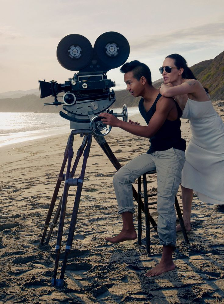 Lights, Camera, Action! - Maddox, age fourteen, and his mom cue up the shot. Jolie Pitt wears a Donna Karan New York slip dress.