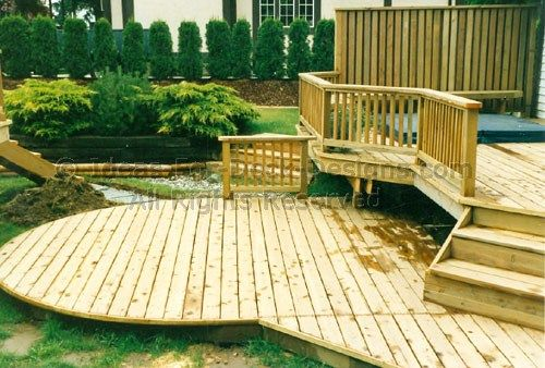 Learn how to build above ground pool decks that fit well with your backyard. See how this backyard deck wraps around a pool and hot tub to complete this home.