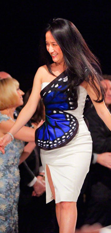 Luly Yang wearing her own Butterfly dress design