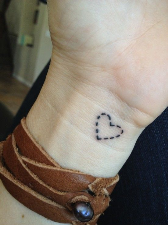 Stitched heart tattoo on wrist.
