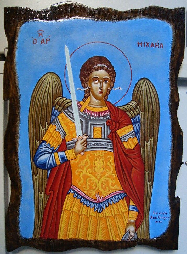 Archangel Michael in aged wood