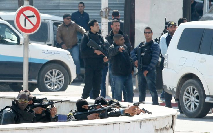 Armed police officers take up positions outside parliament in the Tunisian capital Tunis during the armed siege at the Bardo Museum