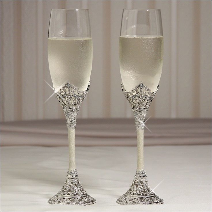 "Silver-plated stems with rhinestone-studded crowns embracing glass bowls.  9.25"" tall.  Toasting glasses can be custom engraved with your choice  #timelesstreasure"
