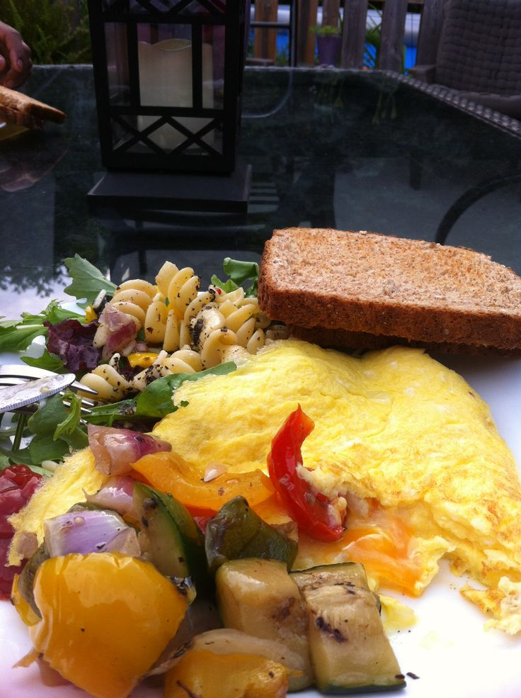 Roasted veggies, a simple salad and eggs...my favourite on a humid evening!