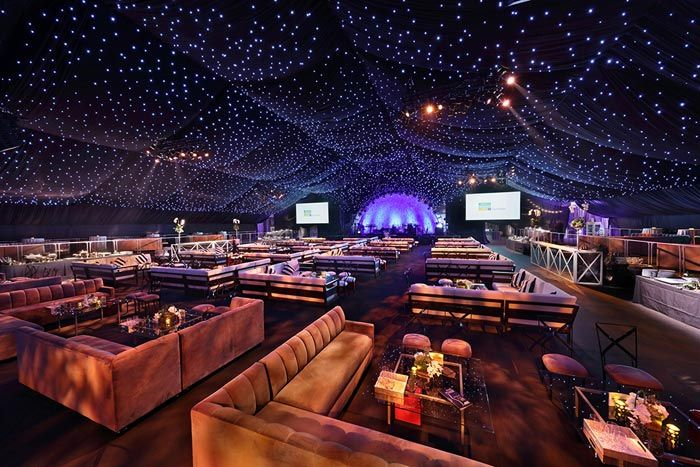 Fiber-optic panels hung from the roof of the City of Hope gala tent to create the look of a...