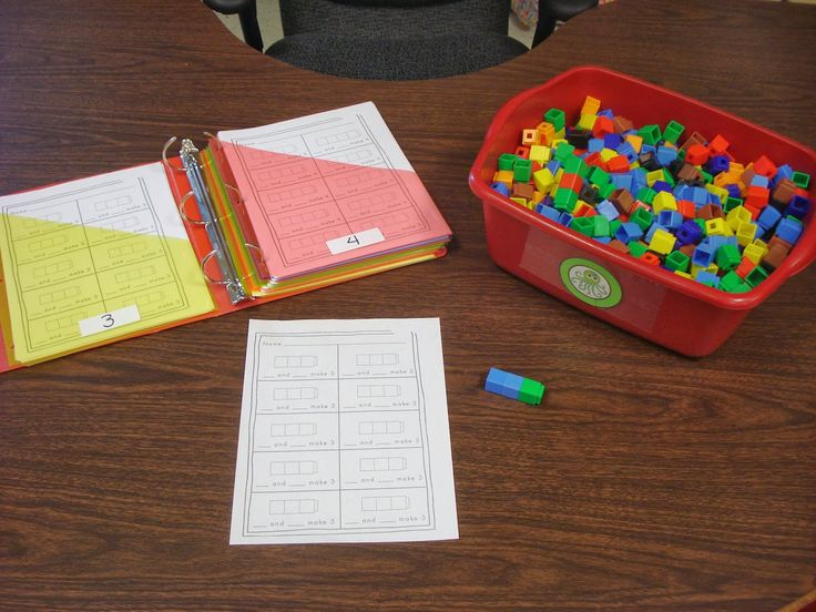"""Train Game The students use 2 colors of cubes to build a """"train"""". They color the recording sheet to match the cubes and write the number combination."""
