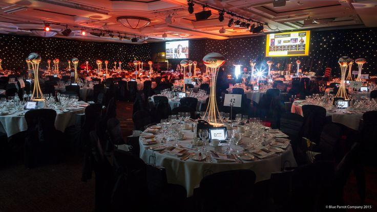Hilton sporting dinner. Football LED table centres. Table Art. Black starlit draping. Linen.
