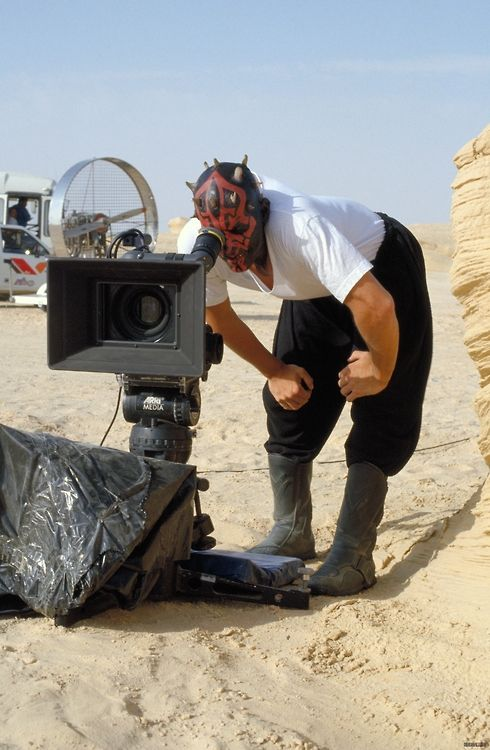Darth Maul (played by actor Ray Park) behind the camera.