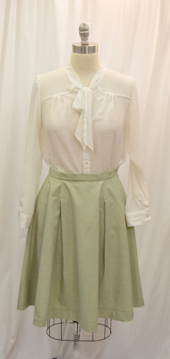 Based off of an original garment, this lovely 1940s inspired skirt is perfect for both vintage and modern wear. Made of a soft green linen, this skirt features a side zipper with hook and eye closure and front and back box pleats. Measurements: Waist: 30 Length: 25  LISTING IS FOR THE SKIRT ONLY! Blouse is not included in this listing.  Not your size? Contact me to have one custom made just for you